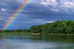 Rainbow over the lake Royalty Free Stock Photos