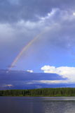 Rainbow over lake Royalty Free Stock Images