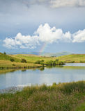 Rainbow over a lake Royalty Free Stock Photos