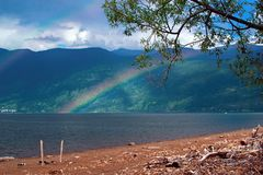 Rainbow over the lake in Royalty Free Stock Image