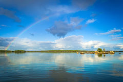 Rainbow over the lake Royalty Free Stock Images