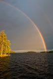 Rainbow over lake Royalty Free Stock Photography