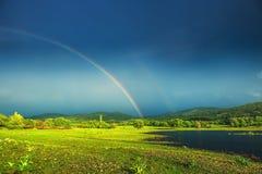 Rainbow over a lake Stock Photos