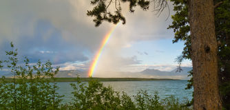 Rainbow over Lake Laberge, Yukon T, Canada Stock Photography