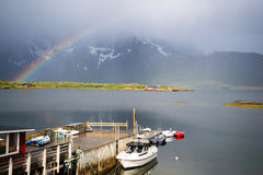 Rainbow over a lake, Lofoten Islands. Photo of a rainbow over a lake in fishing village on Lofoten Islands, Norway. Nature photography royalty free stock photos