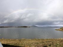 rainbow over Lake Myvtan royalty free stock photos