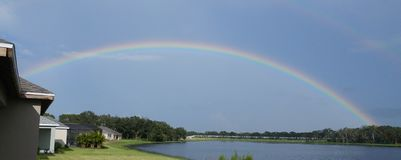 Rainbow Over Lake stock photo