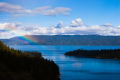 Rainbow over Lake Tahoe. Rainbow with lake tahoe with trees Stock Images