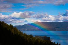 Rainbow over Lake Tahoe royalty free stock photo
