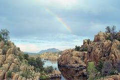 Rainbow over Lake Watson. Prescott Arizona. broken sky and majistic rock formations Stock Photo