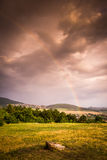 Rainbow over Landscape Stock Image