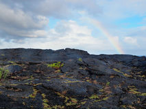 Rainbow over lava field Royalty Free Stock Photography