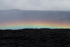 Rainbow over a lava field Royalty Free Stock Photos
