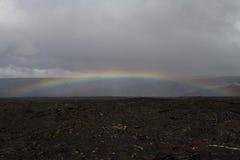 Rainbow over a lava field Stock Photography