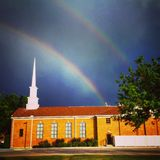 Rainbow over LDS church. Royalty Free Stock Photography