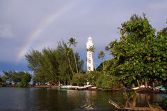 Rainbow over the lighthouse. At venus point, tahiti Stock Photography