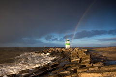 Rainbow over lighthouse and North sea Royalty Free Stock Image