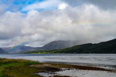Rainbow over the Loch Linnhe. In western highlands of Scotland Royalty Free Stock Images