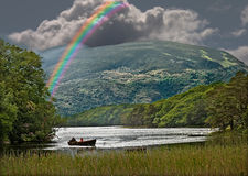Rainbow over the Lough. A rainbow over a lough in Connemara, Ireland Stock Photos