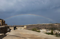 Rainbow over malta. Island with dark clouds Royalty Free Stock Images