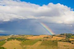 Rainbow over marche hills Stock Photos