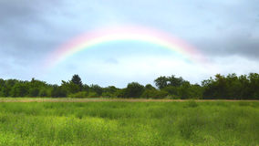 Rainbow over the meadow Royalty Free Stock Images