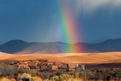 Rainbow over Morocco village in desert Royalty Free Stock Photos