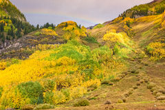 Rainbow Over a Mountain Landscape in Autumn Stock Photography