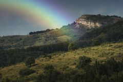 Rainbow over mountain landscape in summer royalty free stock photos