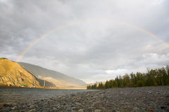 Rainbow over the mountain river Stock Image