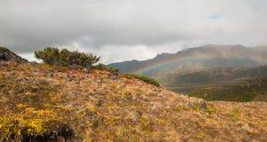 Rainbow over a mountain valley, Kamchatka Stock Photo
