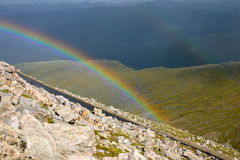 Rainbow over mountain valley Royalty Free Stock Photography
