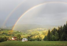 Rainbow over the mountains stock photography