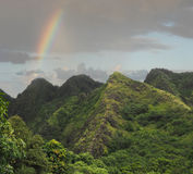 Rainbow Over the Mountains of Maui. Rainbow Over the Lush Jungle Covered Mountains of Maui royalty free stock images