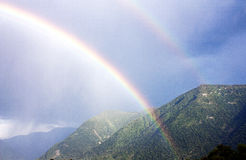 Rainbow over the mountains royalty free stock image