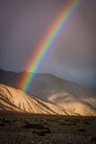 Rainbow over mountains Stock Images