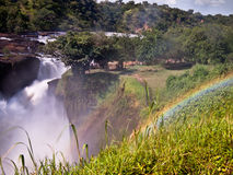 Rainbow over the Murchison falls. On the background of trees to the sky Royalty Free Stock Photo