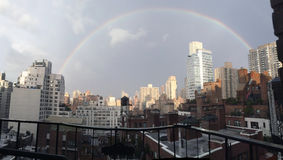 Rainbow. Over New York city skyline Stock Image