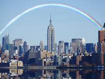 Rainbow over New York skyline stock images