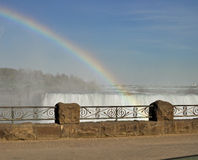 Rainbow over Niagara Falls. Mist and rainbow over Niagara Falls royalty free stock images