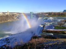 Rainbow over Niagara Falls and Rainbow Bridge. View of American Falls (between Prospect Point and Luna Island), Bridal Veil Falls (between Luna Island and Goat Stock Photos