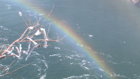 Rainbow over niagara falls water. Video of rainbow over niagara falls water stock footage