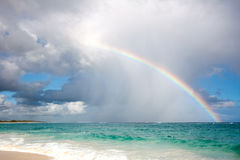 Rainbow over the ocean. On a stormy day stock photography