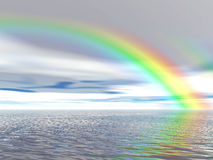Rainbow over ocean Stock Images