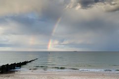 Rainbow over ocean Royalty Free Stock Image