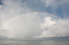 Rainbow over ocean. Colorful rainbow over ocean after storm Stock Image