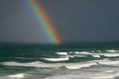 Rainbow over the ocean Stock Photos