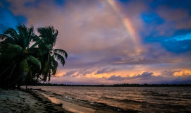Rainbow over the ocean Stock Images