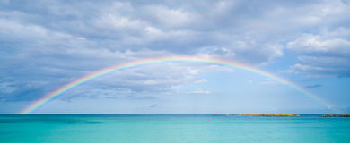 Rainbow over ocean. In Mexico for hoizontal banner