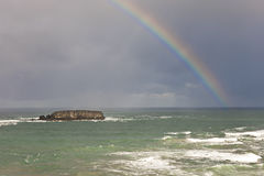 Rainbow over the ocean. Royalty Free Stock Photography